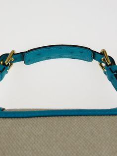 An elegant and sophisticated blend makes this Louis Vuitton Limited Edition Sac de Nuit Toile Trianon Canvas Turquoise Ostrich Sac Express PM Bag truly desirable. The Sac Express PM was from Louis Vuitton's Spring-Summer 2004 runway collection and was created in conjunction with Louis Vuitton's 150th anniversary. This extremely rare and stunning bag features nostalgic elements that reminds one of some of the first Vuitton luggage's. It is crafted of Toile Trianon Canvas with turqu...