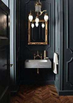 Dark colors are sexy and bold, expecially in half baths. However, I would suggest a lighter color in the vanity area where grooming activities take place.  2017 Bathroom Trends dark colors