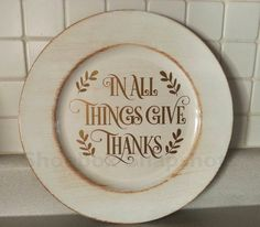 This charger plate will make the perfect addition to your autumn and Thanksgiving décor!  This 13 diameter charger plate is cream color with golden accents. The wording is created in matte gold permanent vinyl and is 7.5 in diameter. To preserve the design on this plate, never place food on the vinyl area unless it is protected with waxed paper, parchment paper, or a cloth. Hand wash only -- no dishwasher or microwave. Do not soak or scrub. I ship USPS First Class or Priority Mail to the US…