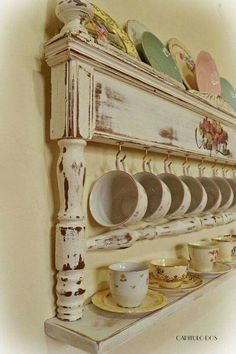 Vintage foot board turned into a cup holder. Pretty. :)