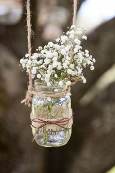 Hanging DIY mason jar at our wedding ceremony.