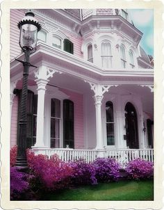 I love this shade of pink & the old Victorian style houses (and the flowers, and the lamppost, etc.)