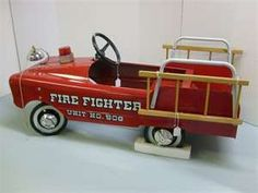 I used to ride in one of these fire trucks for kids…I wish I could still fit...!! #Fire Fighter Peddle Car #MEMORIES