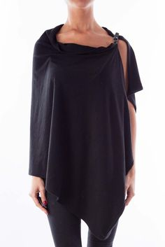 3fb7ab08ab846 Fashionable tops versatile for all occasions black poncho by Isabel De Pedro