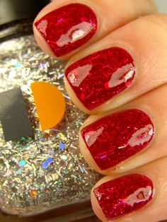 Coat of glitter in between two layers of color. Glitter polish is Dare to Wear Disco Ball. Red polish is China Glaze Phat Santa.