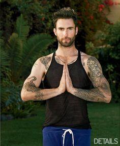 Adam Levine does yoga.