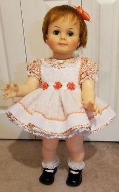 The dress is a pretty off white cotton with a peach floral print. I adore lace. Little girls dresses should be full and frilly so i added a crinoline to this set to aid in the fullness. Her apron is made of a white thin gauze like cotton.