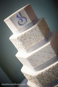 Wedding cake by For Goodness Cakes-- I love the monogrammed letter at the top & that the layers aren't just round...