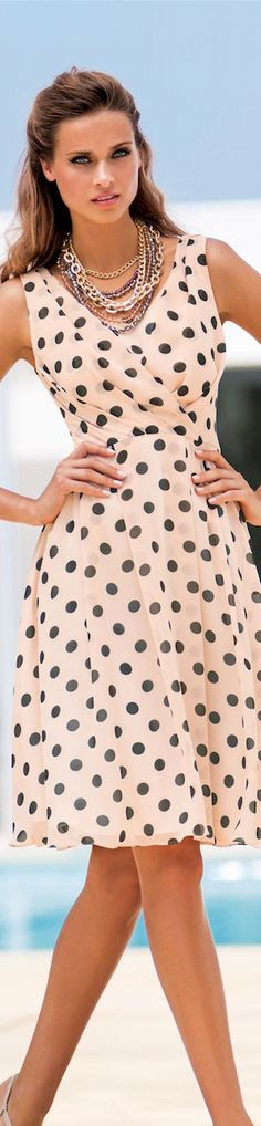 ~ love the cut and design of this dress but will pass on the large polka dots....takes away from the lovely shape of the dress.~