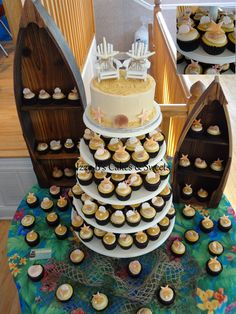 Beach Themed Wedding Cake and Cupcakes.  All seashells are edible (except the ones on the topper)