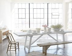 A design the whole family will love, this pine dining table stands tall on a trestle pedestal with a clean white finish and over nine feet of surface and two removable bread-board extensions on...