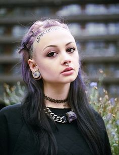 what's pretty and purple and pierced all over? 22-year-old actress, artist and witch zheani sparkes
