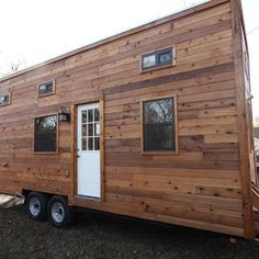 A 192 sq ft tiny home built for a couple who earn a living as wildlife educators and bird experts. Designed by Kim Lewis and built by Canyon Creek Builder.
