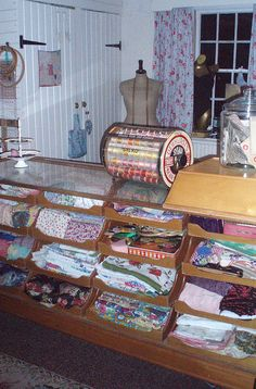 Fabric Room - love the old display case and would commit murder for that round thread display rack! Sewing Room Storage, Sewing Room Organization, Craft Room Storage, My Sewing Room, Sewing Art, Sewing Rooms, Fabric Storage, Sewing Crafts, Craft Rooms