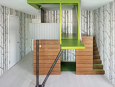 The tree house is constructed from walnut, painted paneling, and steel. The walls surrounding the tree house are papered in Cole & Son's Woods wallpaper,