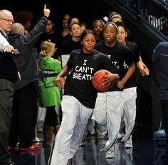 """Notre Dame players wears an """"I Can't Breathe"""" shirts during warm-ups before an NCAA college basketball game against Michigan,  Saturday, Dec. 13, 2014 in South Bend, Ind. Photo: JOE RAYMOND, AP / FR25092 AP"""
