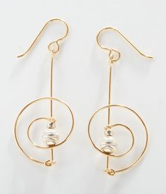 """Circle Wire Earrings - 90  Gold-filled and sterling silver wire is skillfully arched, angled, and adorned with etched bead accents. Handmade in the USA. Handmade jewelry can be found in the museum's permanent collection. 2"""" x 7/8""""  The Museum Shop of The Art Institute of Chicago"""