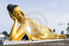 Reclining Buddha gold statue at temple in Phuket, Thailand
