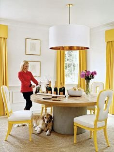 A yellow dining room in the most modern shade of yellow.