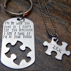 """Personalized Hand Stamped Puzzle Piece Cutout Jewelry Set A Piece of Me In Your Heart Distance Deployment Quote on Dog Tag Style Keychain or Necklace with Matching Puzzle Pendant. This keychain is stamped with the phrase, """"I'll be with you even if I can't see you because I left a piece of me in your heart"""". It comes with a puzzle piece necklace that fits inside the puzzle piece cutout on the keychain. The puzzle piece may be stamped with the name or initials of your choice. All of our…"""