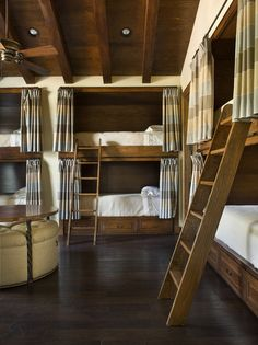 Not sure what to do with all of those beds, obviously, but if I ever became filthy rich, I would love to have this room. The only change would be a cubby/shelf in the wall behind each bed for personal storage.