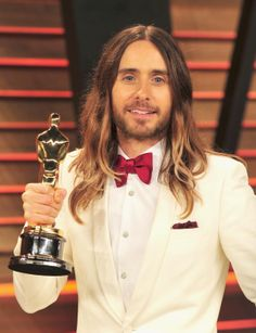 Jared Leto shows off his Oscar at the Vanity Fair Oscar Party on March 2, 2014 in Los Angeles.