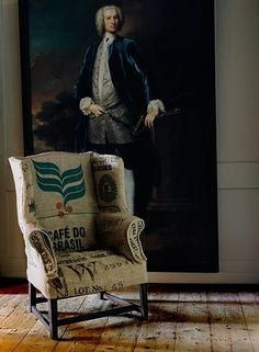 contrast of wingback covered in statement fabric in front of traditional painting.  This fabric is too rustic for me though.