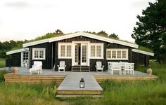 Beach house with sea grass and deck. - The perfect vacation home! Beach Cottage Style, Coastal Cottage, Coastal Living, Cabins And Cottages, Beach Cottages, Navy Blue Houses, Cap Ferret, Timber House, Timber Deck