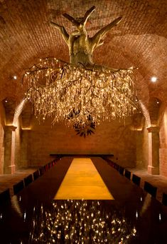 This elegant chandelier, designed to look like a massive grapevine laden with 1,500 Swarovski crystal 'grapes,' was crafted by Donald Lipski and Jonquil LeMaster. This sculptor-artist duo created the chandelier for the Kathryn Hall vineyard, a wine producer in Rutherford, California.