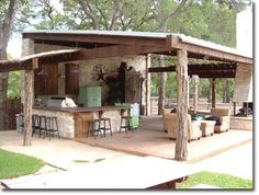 Rustic outdoor living space!  Really like this!