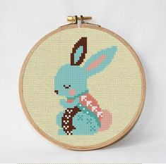 Easter Rabbit cross stitch pattern ❤ ❤ ❤ You can always find and download them here: You> Purchases and reviews  ❤ PATTERN DETAILS ❤ Fabric: 14 count Aida, Any fabric you like Stitches: 35*55 Size: Width: 6,35 cm Height: 9,98 cm (2.86 / 4,14) Floss: DMC, Anchor, Madeira (14 colors) 6 colors Use 2 strands of thread for cross stitch  This pattern is in PDF format and consists of an example photo, a floss list DMC, Anchor, Madeira and a color symbol chart. You can see a small sample of t...