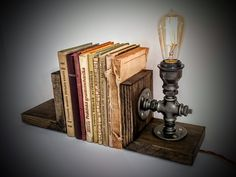 Bookends (book holders, book stoppers) designed for Octavo x x cm) size books. Great piece of steampunk furniture! Made from linseed oil stained and waxed pine wood in dark grey color and industrial pipe fittings. These bookends will Industrial Furniture, Steampunk Lamp, Steampunk Furniture Decor Ideas, Edison Lamp, Vintage Industrial, Book Holders, Steampunk Furniture, Bookends, Vintage Industrial Furniture