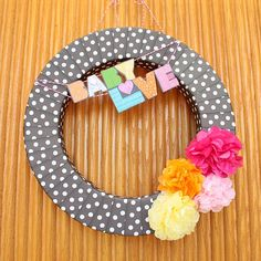 """The cutest DIY wreath made out of the Tiny Prints Baby Shower Invitation """"Fabricated Love!"""""""