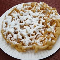 "Famous Amish Funnel Cakes.  This is the real deal.  It's the same recipe that I have always used.  Mine comes from Mary Emma Showalter's ""Mennonite Community Cookbook."""