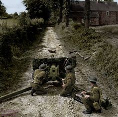Soldier from the 50th Northumbrian Division using a a anti-tank gun QF 6 57mm (6 pounder - ATK/Mk II) in an important way in the area of Lingèvres, Lower-Normandy.