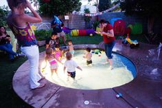 built in sprinkler playground in the backyard. who am i kidding....i'd have this for myself!