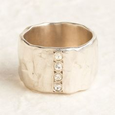 Sterling silver band w/white Topaz stones. So pretty!