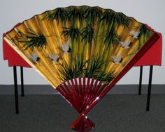 lacquered decorative Japanese fan with cranes and palm fronds; RSOL Attic Sale April 4-6, 2014 from 9 AM to 2 PM and receiving every MWF from 10 AM to 2:30 PM through 3/31/14! — at 8010-8012 Staples Mill Road Richmond, VA 23228.