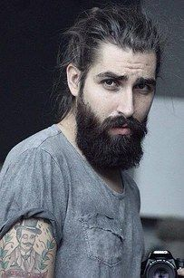 This handsomely hairy hunk. | 23 Beard And Man Bun Combinations That Will Awaken You Sexually