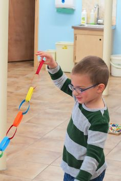 Paper chain making is relatively simple, yet requires incredible concentration and gives those finger muscles a fine-motor workout. Paper Chains, Four Year Old, Learning Through Play, How To Make Paper, The Incredibles, Children, Blog, Young Children, Kids