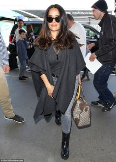 Flying high! Salma Hayek was all smiles as she jetted out from the LAX airport on Tuesday afternoon