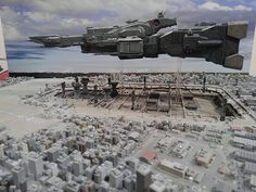 ネコワークス井上さんのTwitterより転載。大阪で行われてるモデラーズフェスティバルより マクロスのジオラマ。地上の建造物全て造形物でマクロス艦浮上するギミックもあるそうです、ファイバースコープで市街地から見上げてみたい(≧∀≦) #マクロス  #モデラーズフェスティバル