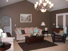 great brown living room color schemes. i like this but i'd want a place to store blankets #decor #livingroom