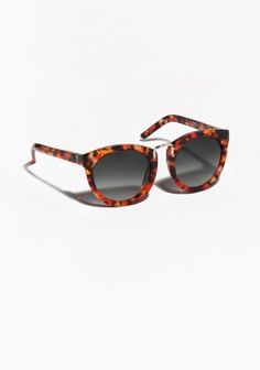 Crafted from acetate, these sunglasses have a rounded front with femininely  marked outer edges and f9c9d55af7d4