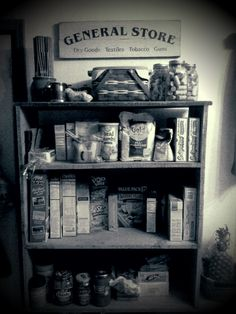 """reused book shelves for kitchen pantry and added a """"general store"""" sign."""