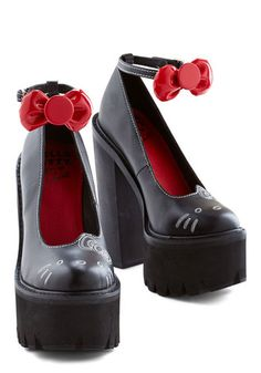 Stride for Purr-fection Heel. Youre bound to fall head over paws for these Hello Kitty pumps from Jeffrey Campbell! #black #modcloth