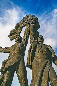 The Soviet era Russian-Ukrainian Friendship Statue, in Kiev, Ukraine.  Oh so big, oh so Soviet.