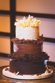 Three tiers of decadence...dark, milk and white chocolate....who could ask for anything more in this wedding cake? Don Mears Photography - Cakes by Graham - More than Just the Icing on the Cake