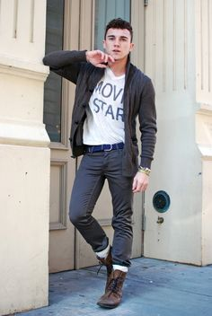 Shop this look for $231: http://lookastic.com/men/looks/v-neck-t-shirt-and-shawl-cardigan-and-jeans-and-socks-and-boots-and-belt/605 — White V-neck T-shirt — Charcoal Shawl Cardigan — Charcoal Jeans — White Socks — Brown Leather Boots — Blue Canvas Belt