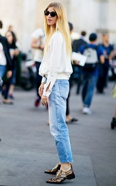 A white blouse is paired with Levi's jeans, oxfords, and square sunglasses